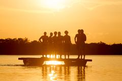 Stock Photo of Group Of People On Laguna Grande Cuyabeno National Park In Ecuador Against