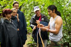 Naturalist Local Guide With Group Of Tourist In Cuyabeno Wildlife Reserve - stock photo