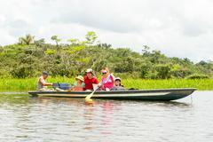 Tourists Fishing Legendary Piranha Fish In Ecuadorian Amazonian Primary Jungle Stock Photos