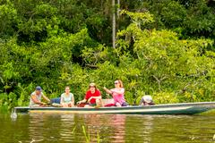 Tourists Fishing Legendary Piranha Fish In Ecuadorian Amazonian Primary Jungle - stock photo