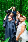 Group Of Tourist In Ecuadorian Amazonian Primary Jungle Looking After Wildlife Stock Photos