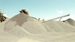 Separation of sand, pan left. Construction industry. Pile, sunny day, blue sky. - stock footage