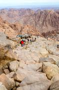 Sightseers go down the long trail from the top of Mount Moses, Egypt - stock photo