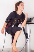 woman exercise on  electro stimulation machine - stock photo