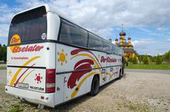 The sightseeing bus in the parking lot in Dudutki, Belarus - stock photo
