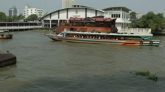 Boats moving past the National Museum of Royal Barges, Bangkok, Thailand Stock Footage