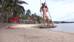 Girl scream with joy and excitement on a beach in thailand - stock footage