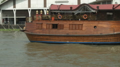Wooden barge docked at National Museum of Royal Barges, Bangkok, Thailand Stock Footage