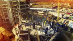Aerial sun day fly over under construction new modern building work builders and Stock Footage