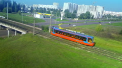 Aerial panorama follow track shot of modern new tram rides through the bridge Stock Footage