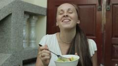 Woman eating salad - stock footage