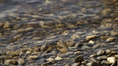 Riverbed with small waves and stones Stock Footage