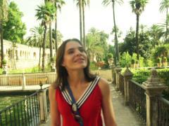 Young, pretty woman sightseeing splendite alcazar in Sevilla   NTSC Stock Footage