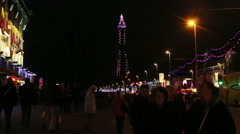 Crowds walking along blackpool sea front Stock Footage