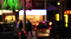 Out of focus street scene shps traffic people Stock Footage
