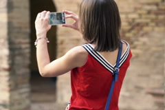 Young woman taking photo of ancient architecture in alcazar in Sevilla  NTSC - stock footage
