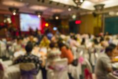 Blurred people sitting in banquet hall Stock Photos