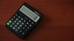 Female hand on the calculator makes calculation Stock Footage