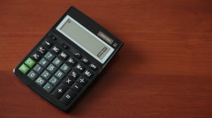 Female hand presses the button on the calculator Stock Footage