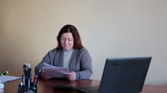 Woman employee in the office scatters documents upset tired Stock Footage