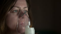 The woman wears a mask for inhalation and makes medical procedures Stock Footage