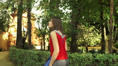 Young, pretty woman sightseeing alcazar garden in Sevilla   HD - stock footage