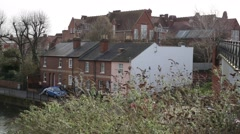 English urban houses by the river  Stock Footage