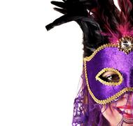 Portrait of a woman wearing a carnival mask Stock Photos