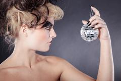 model with fantasy makeup and balls - stock photo