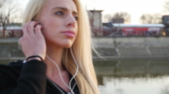 Stock Video Footage of Sport and music, beautiful young woman with mp3 player