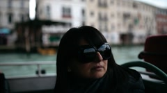 Woman on a boat navigating through Venice canals Stock Footage