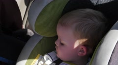 A little boy asleep in a car seat Stock Footage