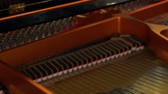 Piano hammers strike the strings. Arkistovideo