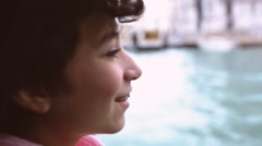Girl on a boat navigating through Venice canals Stock Footage
