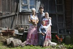 Vintage styled family portrait with some hens Kuvituskuvat