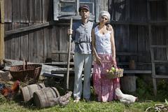 Retro couple on a farm Stock Photos