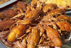Dish of boiled crawfish closeup Stock Photos