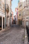 Narrow street of Coimbra Stock Photos