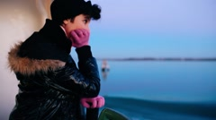 Girl on a boat navigating through Venice canals - stock footage