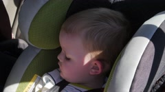 A little boy sleeping in a car seat Stock Footage