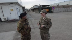 two soldiers women talk to each other inside the military base - stock footage