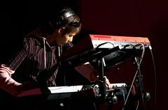 girl playing on synthesizer - stock photo