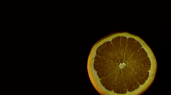 Orange slices fly and spin Stock Footage