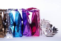 Metallic shopping bags and shoes Stock Photos