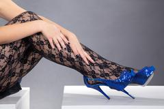 beautiful legs with high heels and hands - stock photo
