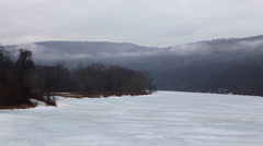 4K UltraHD A timelapse of mist moving over a frozen River Stock Footage