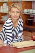 Pretty Woman in Stripe Shirt Leaning on the Table - stock photo