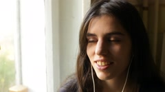Young Adult Woman Listening Music Stock Footage