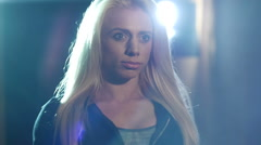 Close-up portrait of a  beautiful attractive blonde woman with lens flare - stock footage