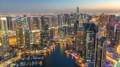Dubai Marina with modern towers from top of skyscraper transition from day to - stock footage